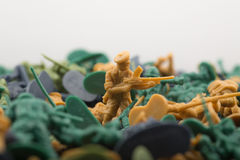 Miniature toy soldier with a riffle. Last action hero - miniature toy soldier with a rifle on a battlefield Stock Photo