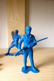 Miniature toy soldier on wood background Royalty Free Stock Photo