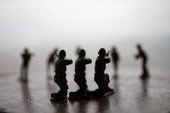 Miniature toy soldiers and tank on board. Close up image of toy military at war. Selective focus royalty free stock images