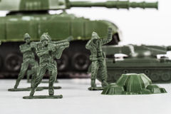 Miniature Toy Soldiers and Tank Stock Image