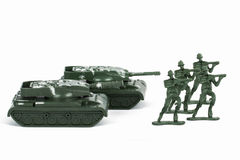 Miniature Toy Tank and Soldiers Stock Photos