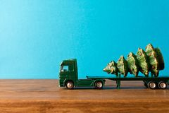 Miniature. Toy truck carries Christmas tree. The concept of Christmas. Empty space for text royalty free stock photos