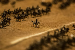 Miniature toys. Macro: miniature soldiers on horses Stock Images