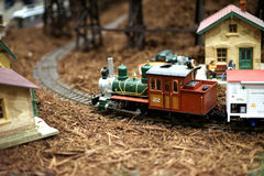 Miniature train leaving town Stock Image
