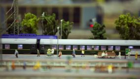 Miniature train station. Passenger train on the station platform close to tilt film stock footage