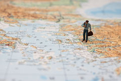 Miniature traveler on map Royalty Free Stock Photography