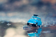 Miniature travelling car with luggage on top. Macro photography Royalty Free Stock Image