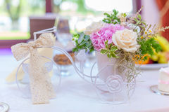 Miniature tricycle flower arrangements. Wedding flower arrangements with lace ribbon, roses and hydrangea Royalty Free Stock Photography
