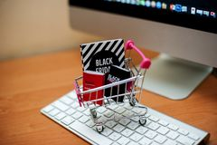 Miniature trolley with packages black friday on keyboard stock photo