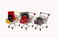 Miniature trolleys with black friday packages stock photo