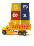 Miniature truck. Loaded with cubes featuring numbers Stock Photos
