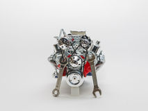 Miniature truck aluminum engine with hand tool, combination wrenches at front Royalty Free Stock Image