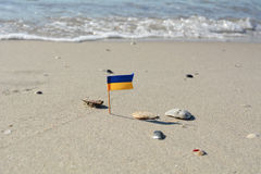 Miniature Ukrainian flag on the beach of the Black Sea selective focus Stock Photography