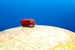 Miniature van on globe Stock Photo