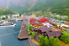 Miniature view of Flam port. A view of small town Flam in one of the fjords in Norway. It was a dull, rainy and colourless day. However, generating a miniature stock image