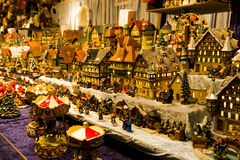 Miniature village in winter time, made of toys. Royalty Free Stock Photography