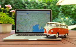 Miniature VW Bulli 1962 on laptop. Royalty Free Stock Images
