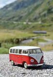 Miniature VW Bulli 1962 on the rural road Stock Photography