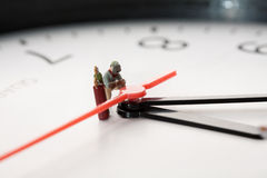 Miniature Welder At Work. A miniature figurine of a welder kneels alongside his acetylelne tanks Royalty Free Stock Photography
