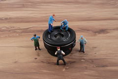 Miniature woker checking the lens Stock Image
