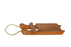 Miniature wooden brown Sleigh. With pull rope made out of twine, isolated on white Royalty Free Stock Images