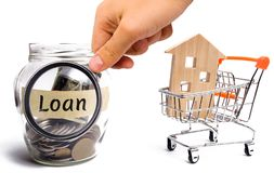 Miniature wooden house and the inscription ` Loan `. Buying a home in debt. Family investment in real estate and risk management c. Oncept. Loan for a mortgage royalty free stock photo