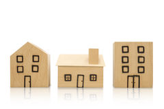 Miniature wooden houses on white background. Clipping paths incl Stock Photography