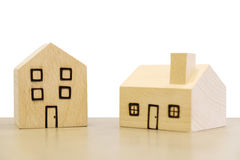 Miniature wooden houses on white background. Clipping paths incl Royalty Free Stock Image