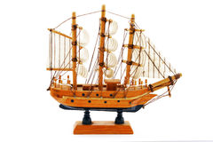 Miniature wooden model of sailboat isolated on white background Stock Image