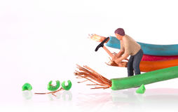 Miniature worker with pickaxe Royalty Free Stock Photos
