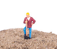 Miniature worker with a shovel Royalty Free Stock Photos