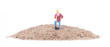 Miniature worker with a shovel Royalty Free Stock Photo