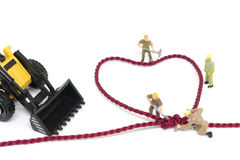 Miniature worker team building Heart Shaped with rope Royalty Free Stock Images
