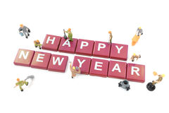 Miniature worker team building word happy new year Royalty Free Stock Photos