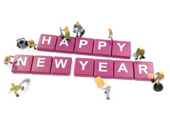 Miniature worker team building word happy new year Royalty Free Stock Photo