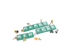 Miniature worker team building word happy new year Royalty Free Stock Image