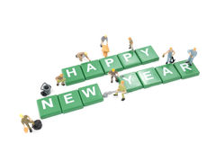 Miniature worker team building word happy new year Stock Images