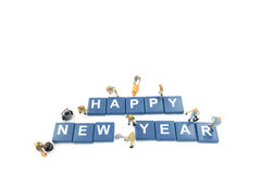 Miniature worker team building word happy new year Stock Photography