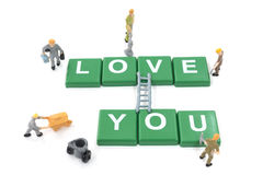 Miniature worker team building word love you Stock Images