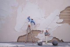 Miniature worker team repair house royalty free stock photo
