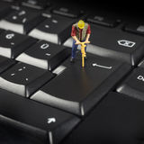 Miniature Worker On Top Of Black Computer Keyboard Royalty Free Stock Photography