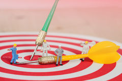 Miniature worker toy on red dart board Royalty Free Stock Photos