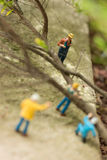 Miniature workers clearing fallen trees top view Royalty Free Stock Photo