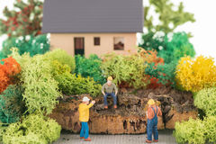 Miniature workers getting ready to renovate the house. Close up Stock Photos