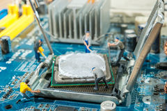 Miniature workers installation CPU. Computer motherboard Stock Images