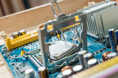 Miniature workers installation CPU. Computer motherboard Royalty Free Stock Photography