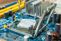 Miniature workers installation CPU. Computer motherboard Stock Image