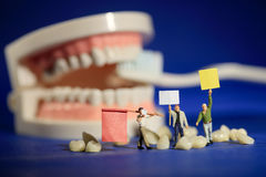 Miniature Workers Performing Dental Procedures. Dental Office Ar Royalty Free Stock Photo
