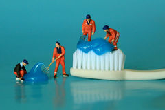 Miniature Workers Performing Dental Procedures. Dental Office Ar Stock Photos