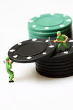 Miniature workers stacking casino chips Royalty Free Stock Image